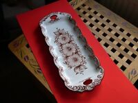 A hand painted Portuguese ceramic sandwich tray.
