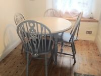 Painted pine round table and four chairs