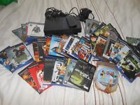 Playstation 2 with 32 games +