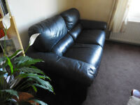 LEATHER SOFA. DARK GREY 2SEAT. CLAW MARKS TO ONE CORNER