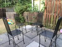 4 wrought iron garden chairs