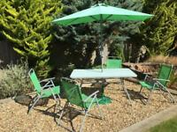 Garden furniture table, 4 folding chairs and unmbrella.
