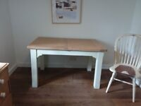 Oak extending dining table with cream painted legs seats 6-8
