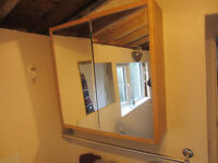 Pine effect bathroom cabinet with mirror doors and two shelves