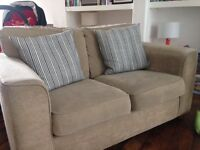 Comfy beige 2 seater sofa for sale. Generally good condition has some minor damage, please see pics