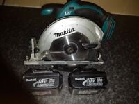 Makita rip saw with 2 3amp batterys