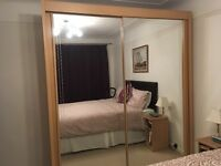 REDUCED FOR QUICK SALE - Double wardrobe with sliding mirror doors