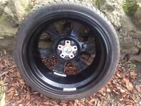 "20"" Calibre Black alloy wheels with new tires"