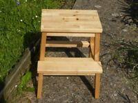 wooden step stool , maybe Ikea Bekvam