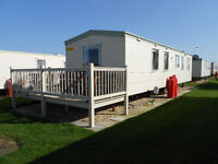 Caravan for hire at coastfield holiday village in ingoldmells