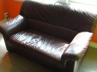 Brown Leather 2 Seater Sofa from clean pet & smoke free home