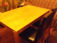 DINING TABLE & TWO LEATHER CHAIRS IN GOOD BOTH SOLID STRONG CAN ARRANGE DELIVERY