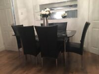 Harvey's Boat glass dining table and 6 leather chairs