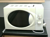 Small Microwave Oven, Almost new.
