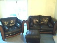 Brown leather two seater settee, matching armchair and pouffe.
