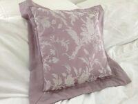 Elegant Laura Ashley cushion with soft border