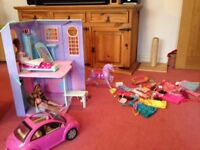 Barbie bundle including dolls house, three barbies, a car, a horse, clothes and accessories