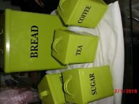 green kitchen storage canisters/cans.