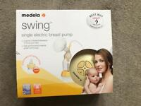 Medela swing single breast pump with Calma teat and 46 milk storage bags
