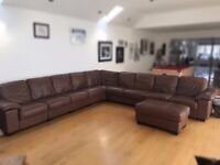 Large brown leather corner sofa with footstall