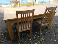 Wood extending dining table with 4 chairs - Almost like New