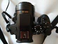 Panasonic Lumix FZ330 with spare batteries, hood, and neoprene carry case