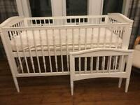 Beautiful White Wooden Cotbed (cot and junior bed) and spring interior mattress.