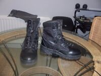 A pair of black leather boots ,size7,thinsulate brand. new condition.
