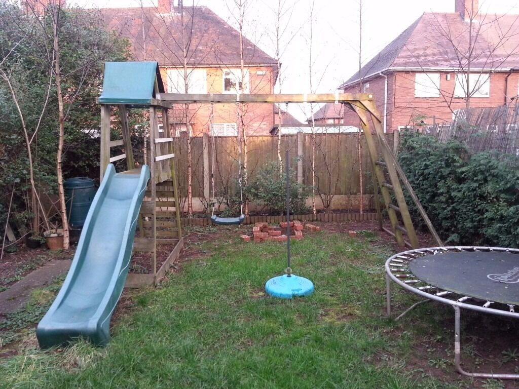 playhouse with swing slide and monkey bars in nottingham