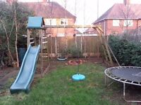 Playhouse with swing, slide and monkey bars!