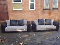 Comfy Brand New black and grey cord sofa suite.3+3. tear to the back. can deliver