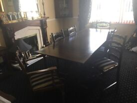Solid oak extending dining table with 6 matching chairs excellent condition.