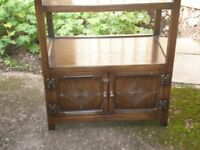 Beautifully carved side table / cabinet with shelf and cupboard. Made by Bevan Funnell of Brighton