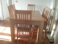 Light colour dining table and 6 macthing chairs - Excellent condition