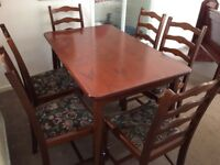 Mahogany dining table and 6 chairs.