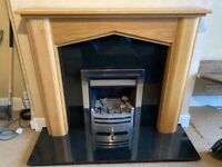 Gas fire with solid oak surround