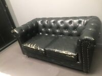 Black 2 seater Chesterfield sofa