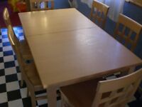 A large dining table and 6 chairs