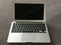 MacBook Air 11 inch (2013) with soft case.