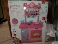 Play kitchen - boxed, excellent condition with light up/cooking sounds hob + extra food - bargain!!
