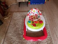 Baby seat on wheels with mini play centre