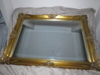 Large antique gold glided mirror