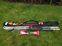 Cross Country Ski Package: Skis; Bindings; Boots; Poles; Waxing Tools, Waxes, and Bag.