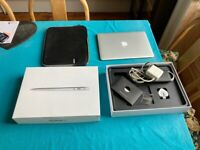 MacBook Air 13 inch with case and TV cable.