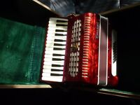 beautiful parrot accordian with original case,in excellent condition,hardly used,always in the case.