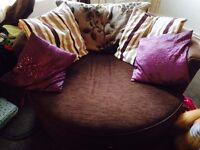 £75.00 for the pair......large chocolate coloured sofa and round spinning armchair, good condition