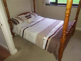 Solid wood four post Double bed.