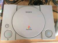 Playstation 1 with controller and 7 games
