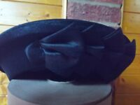 Ladies-pill-box-style-hat-with-side-ribbon-detail