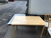 Pine dining room table and chairs for sale.